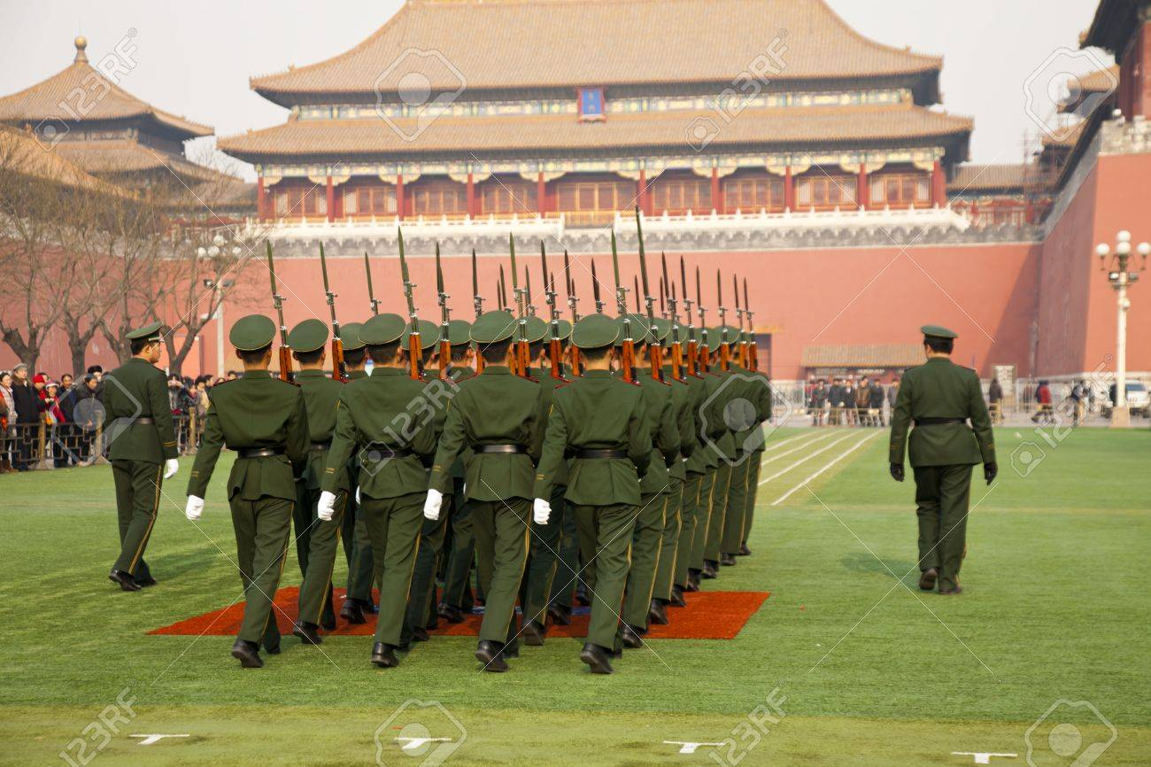 Beijing, China - December 27, 2011. Young soldiers marching in the Forbidden City. Stock Photo - 12716643