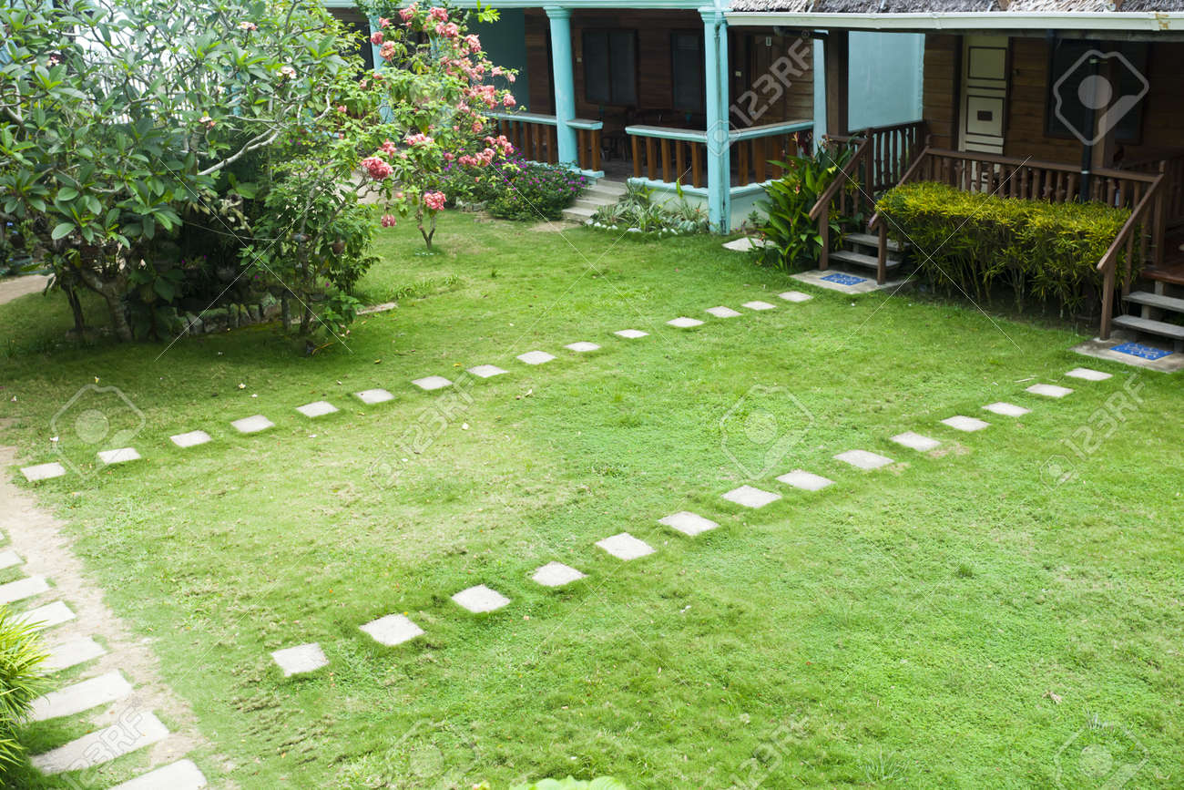 stone paved path to the house in yard tropical resort lally