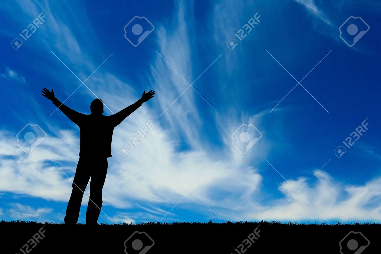 Silhouette of man with arms outstretched to the sky. - 2533194