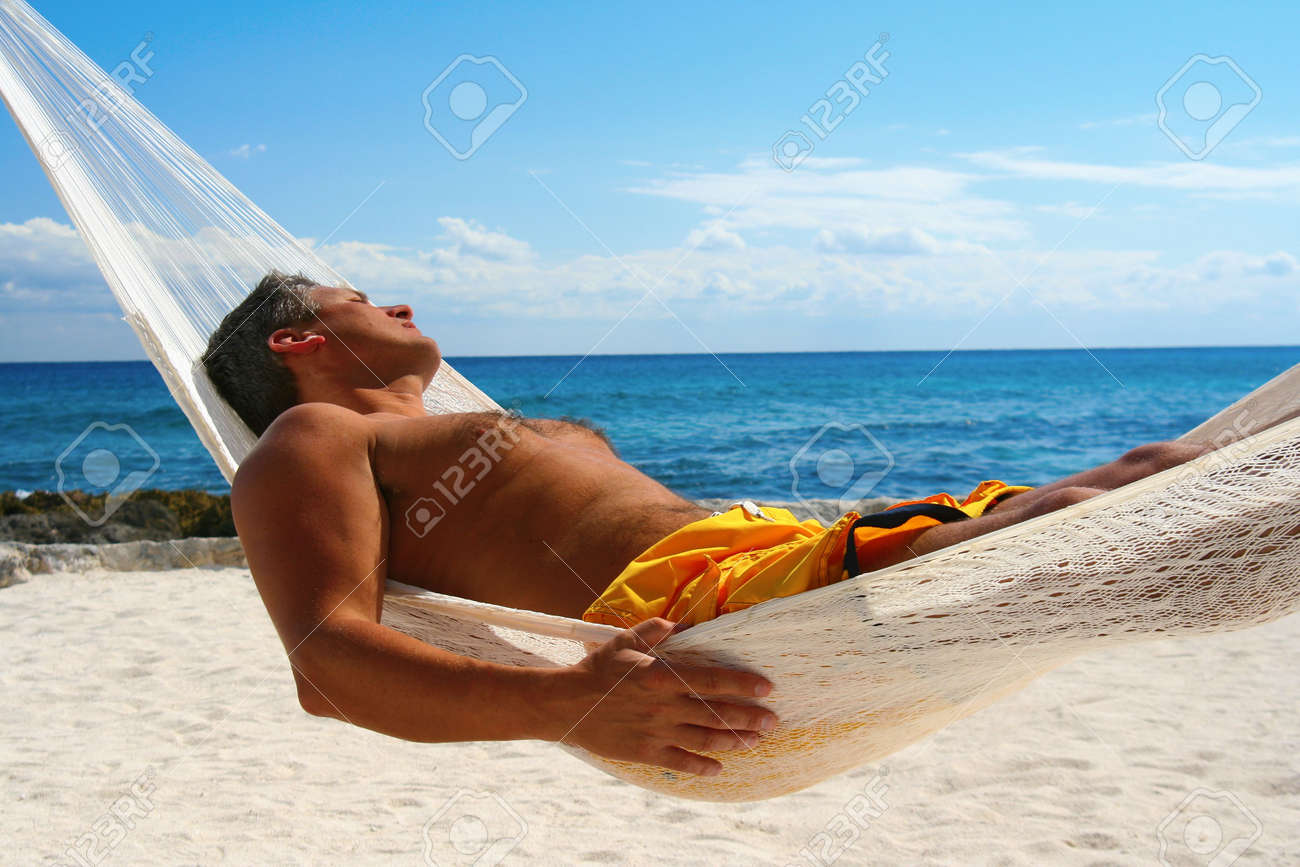 Attractive man asleep in a hammock. Stock Photo - 2533247