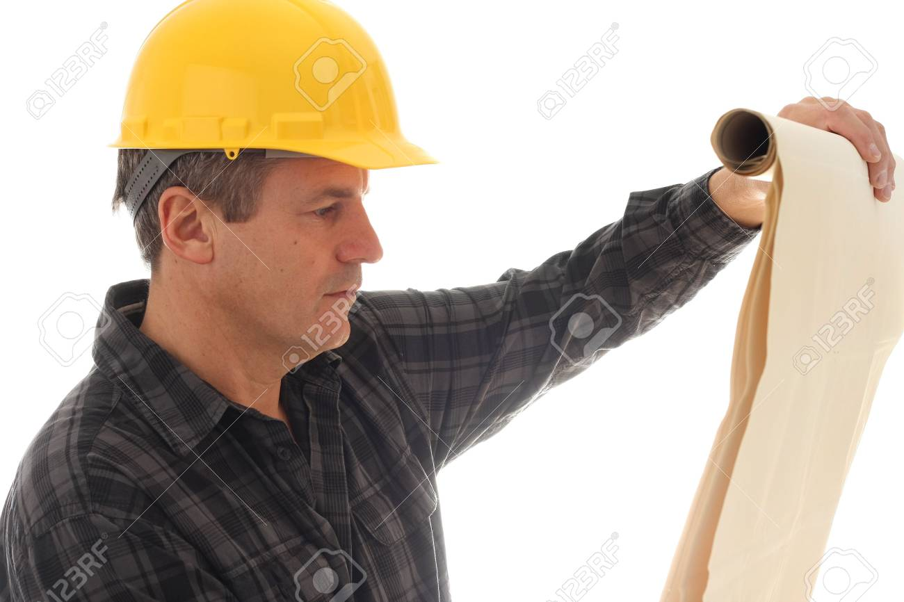 Construction worker studying blue prints. Stock Photo - 5913416