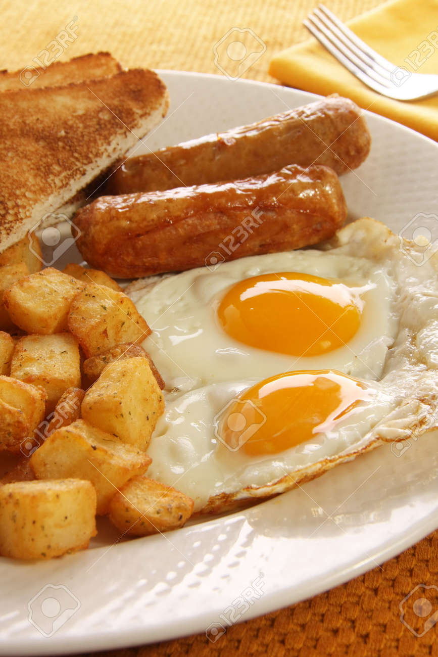 Breakfast of eggs, sausages, toast and hash browns. Also available in horizontal. Stock Photo - 6517875