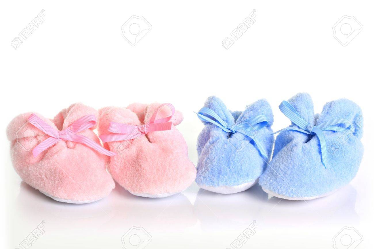 Pink And Blue Baby Booties. Stock Photo