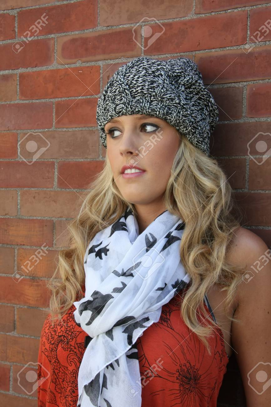 portrait of a stylish young woman against a brick wall. Stock Photo - 7731668