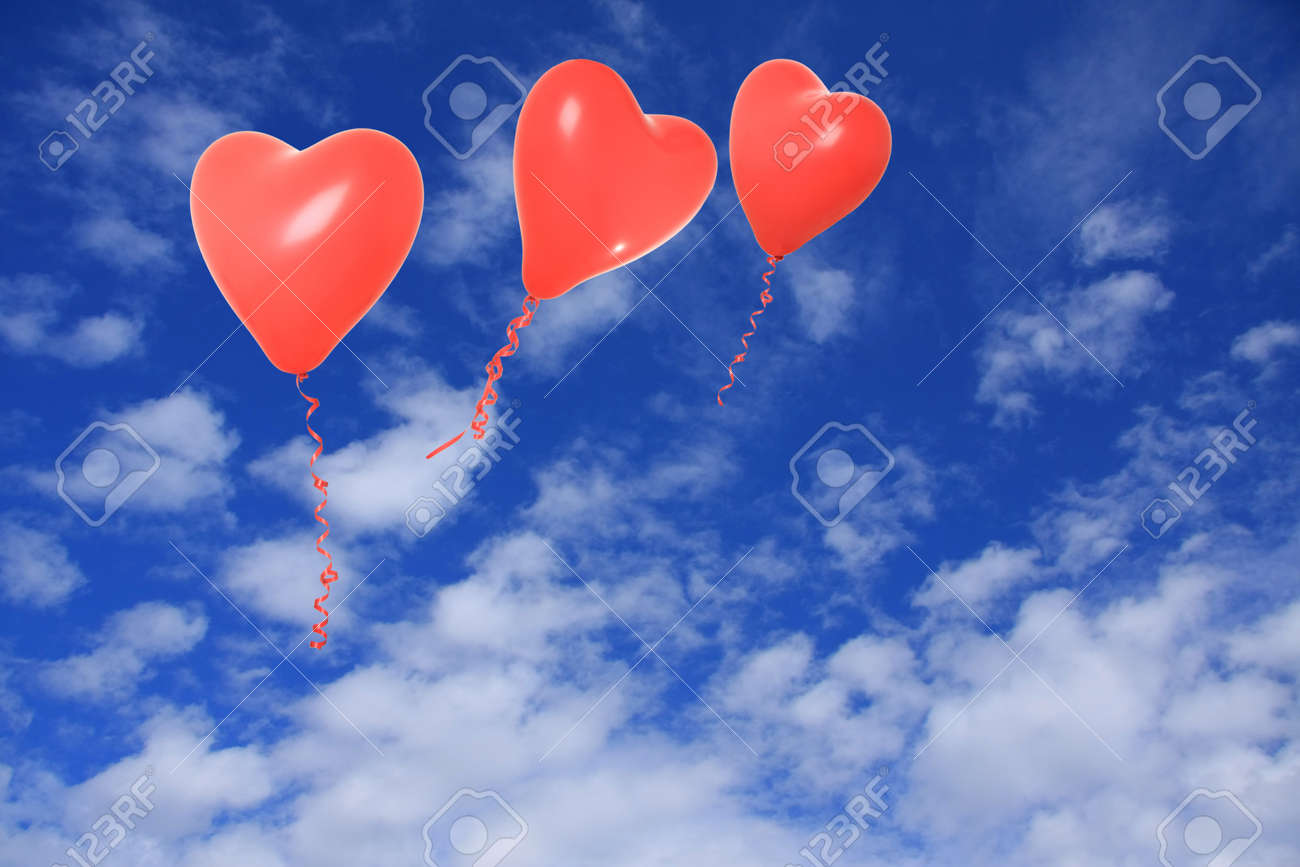 Valentine heart balloons floating in the sky. Stock Photo - 11993574