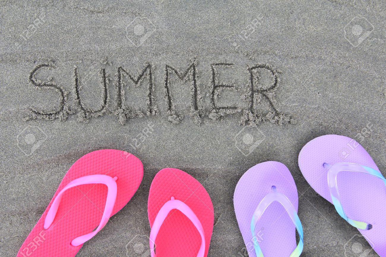 69643fa2df49 Stock Photo - Summer flip flops on the beach
