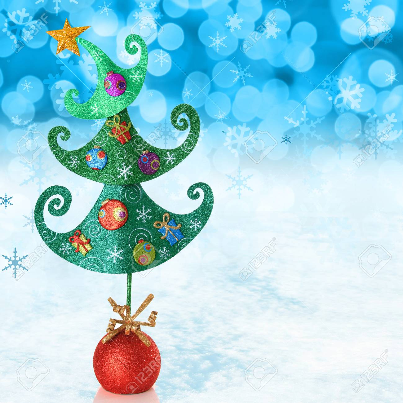 Contemporary Christmas tree on a snowy background Stock Photo - 16295535