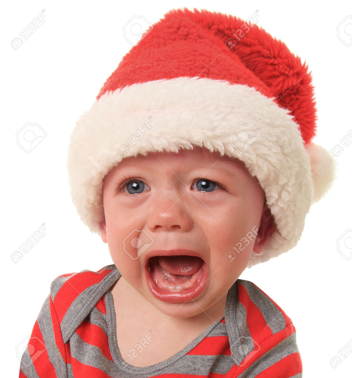 Crying Santa baby boy, 10 months old Stock Photo - 16410847