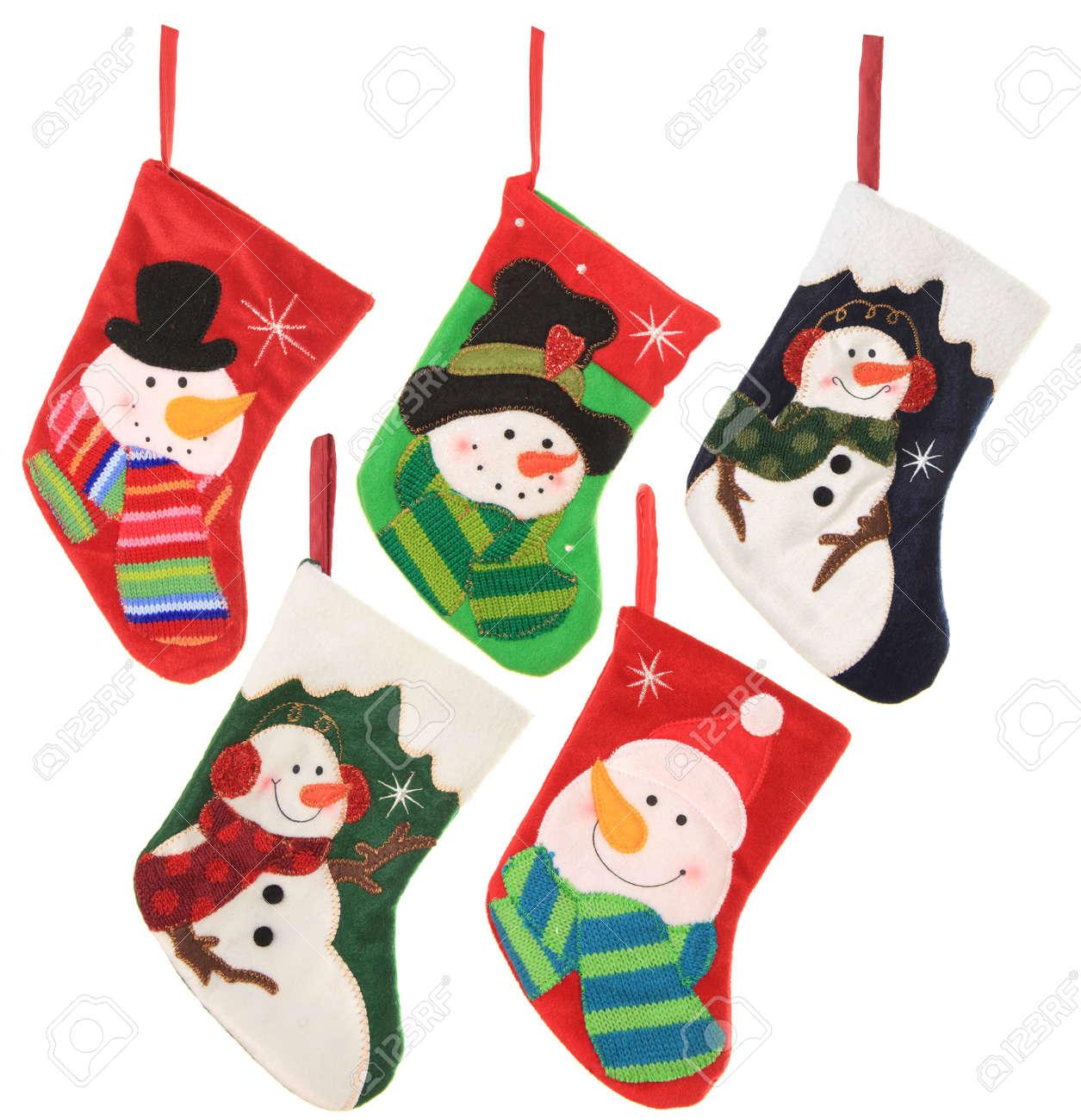 Five friendly snowman Christmas stockings, studio isolated on white Stock Photo - 16482385