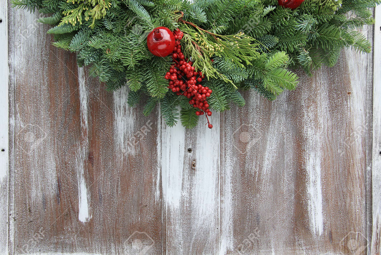 Christmas Garland On A Rustic Wooden Background Stock Photo Picture And Royalty Free Image Image 16505797