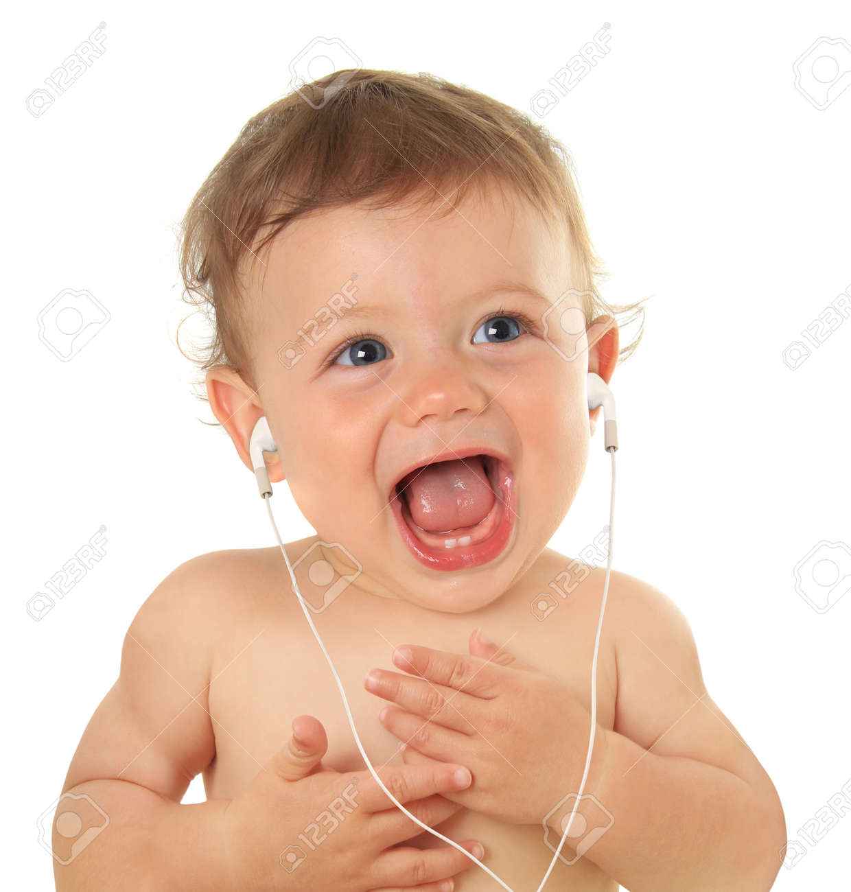 Adorable ten month old baby listening to music on earbuds Stock Photo - 17347936
