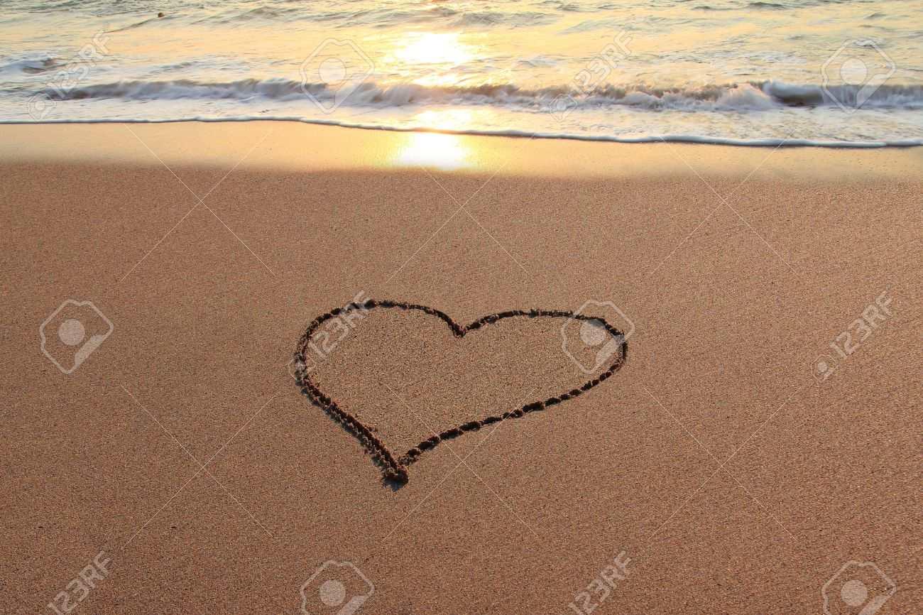 Heart in the sand on the beach at sunset Stock Photo - 17724836