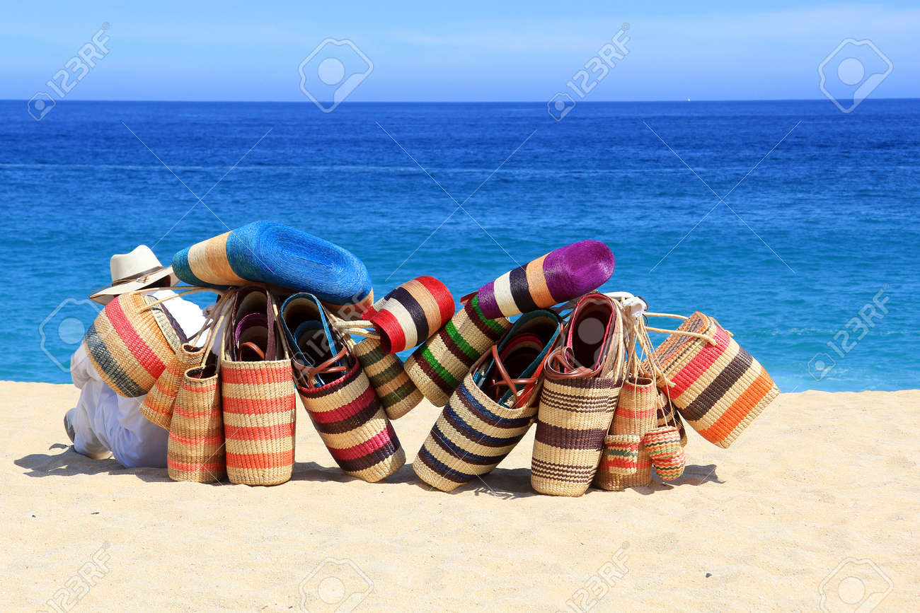 Mexican Vendor With Woven Bags On The Beach Stock Photo, Picture ...