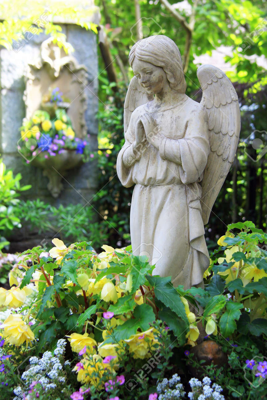 Statue Of A Praying Angel In The Garden Stock Photo Picture And