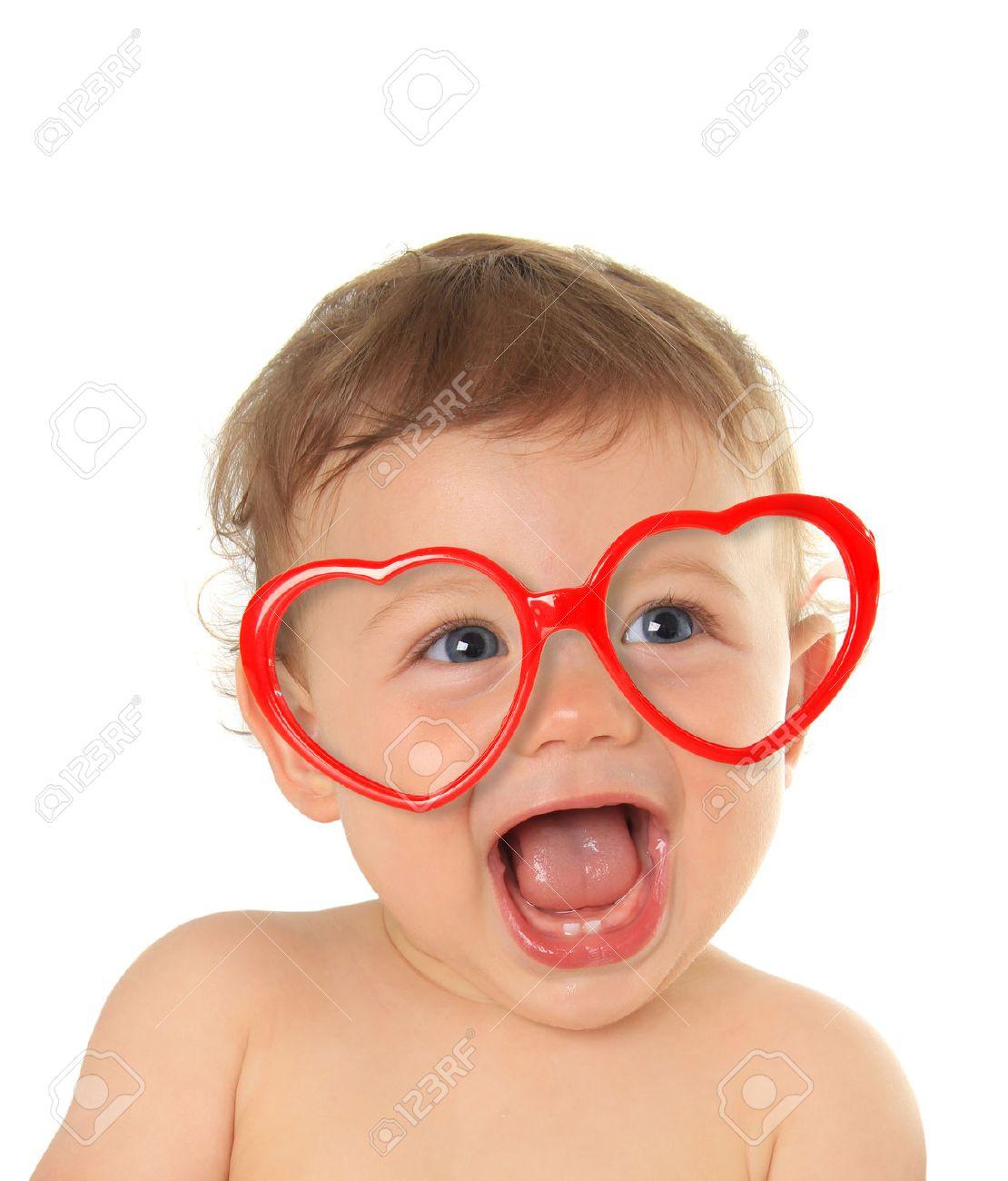Ten month old baby boy wearing heart shape valentine glasses. - 50740500