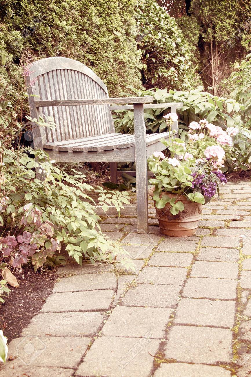 Fine Rustic Garden Bench And Pink Geraniums In Vintage Ncnpc Chair Design For Home Ncnpcorg