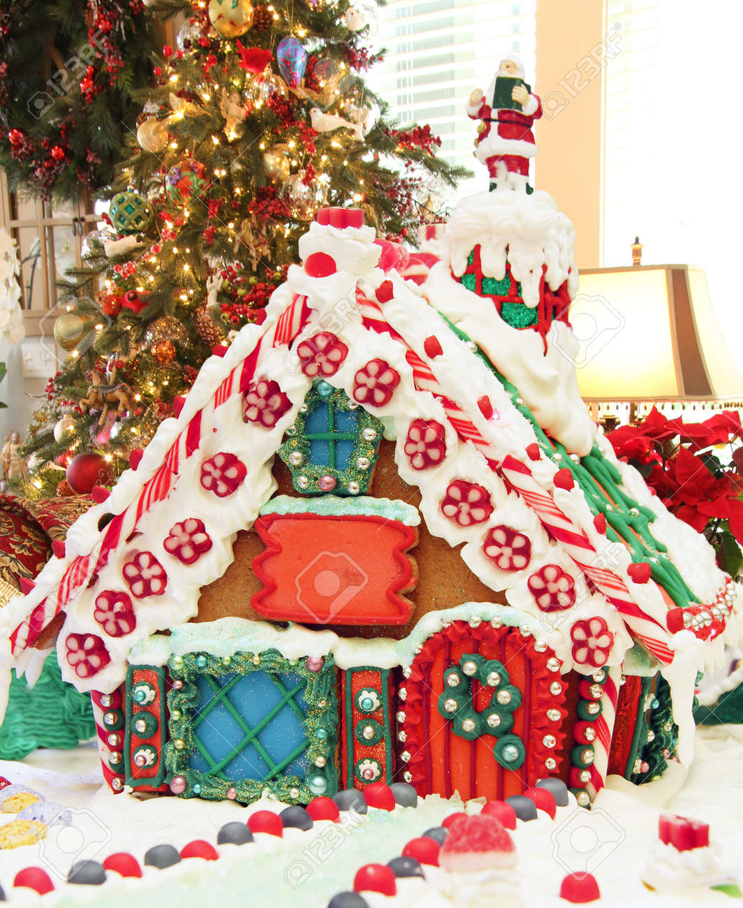 Christmas Gingerbread House Background.Homemade Christmas Gingerbread House With Christmas Tree In The