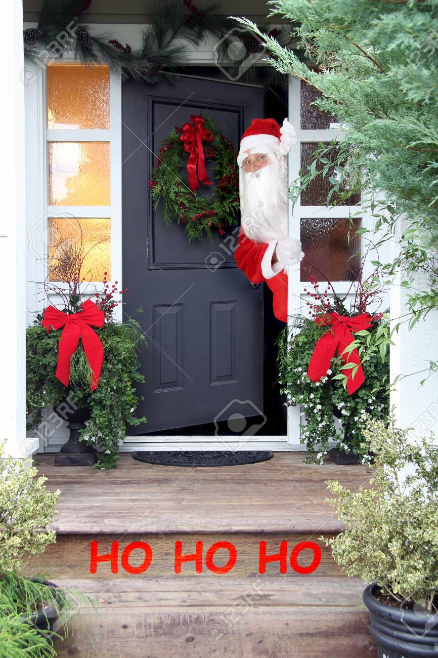 Santa Claus Looking Out Of The Front Door Of A Home, Beautifully ...