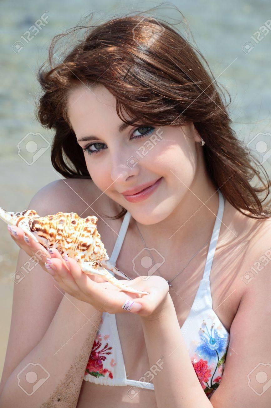 Stock Photo - beautiful teen girl in swimwear holding a seashell - 3096108-beautiful-teen-girl-in-swimwear-holding-a-seashell-Stock-Photo