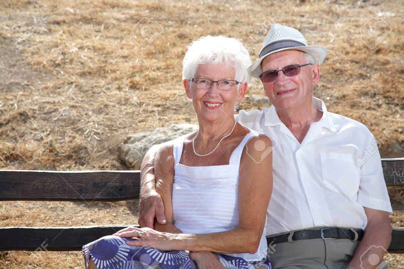 beautiful senior couple smiling relaxing on a bench Stock Photo - 3400039