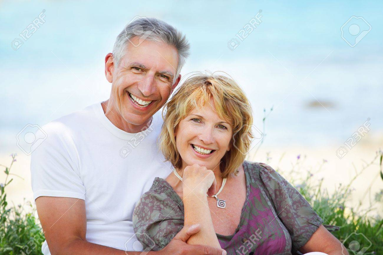 Close-up portrait of a mature couple smiling and embracing. Stock Photo - 7093060