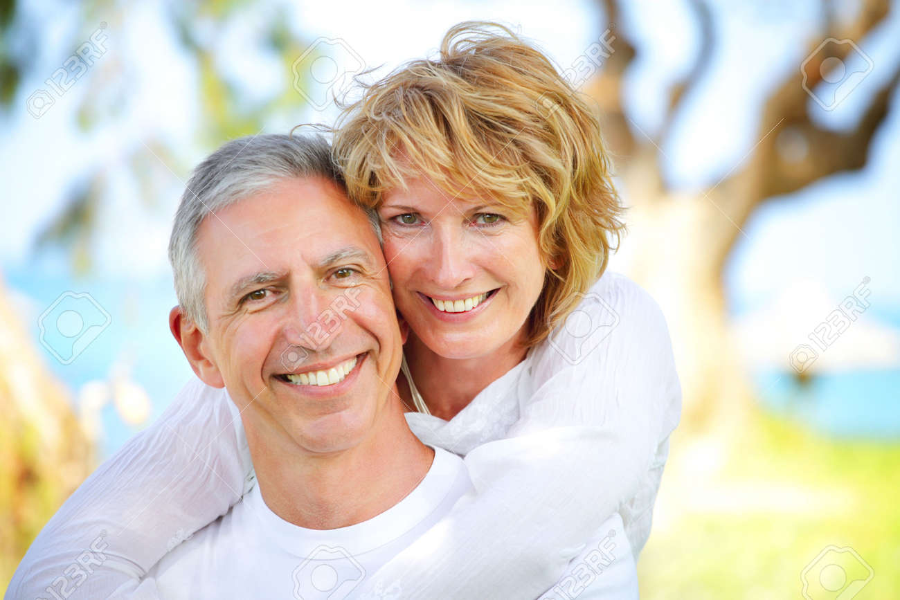 Mature couple smiling and embracing. Focus on the woman. Stock Photo - 7172533