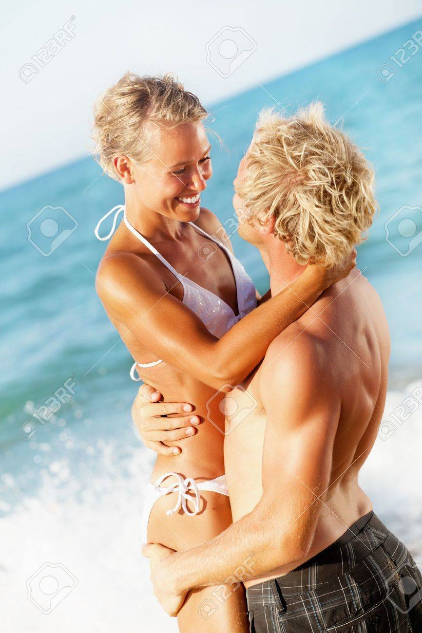 Happy young couple on the beach Stock Photo - 12669087