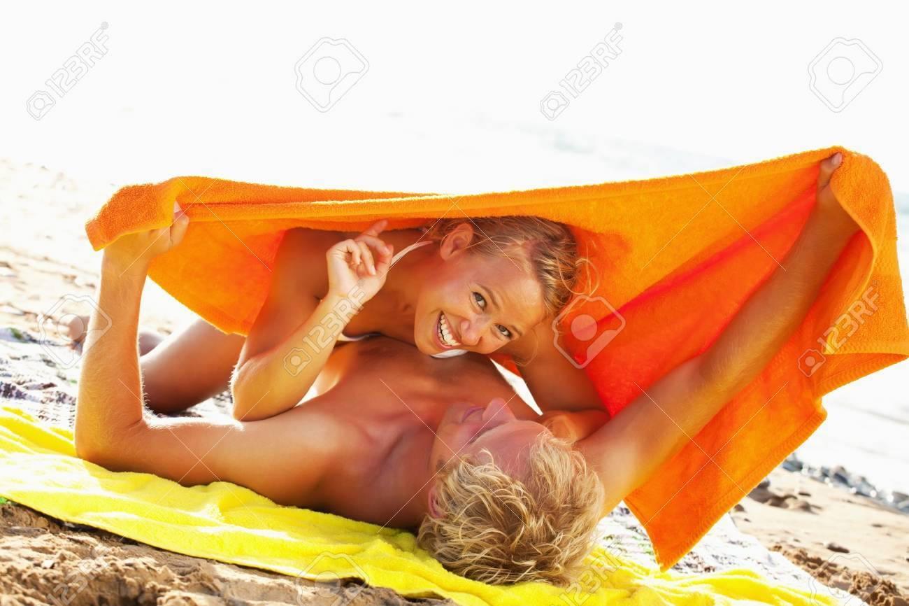Happy young couple on the beach Stock Photo - 12669084