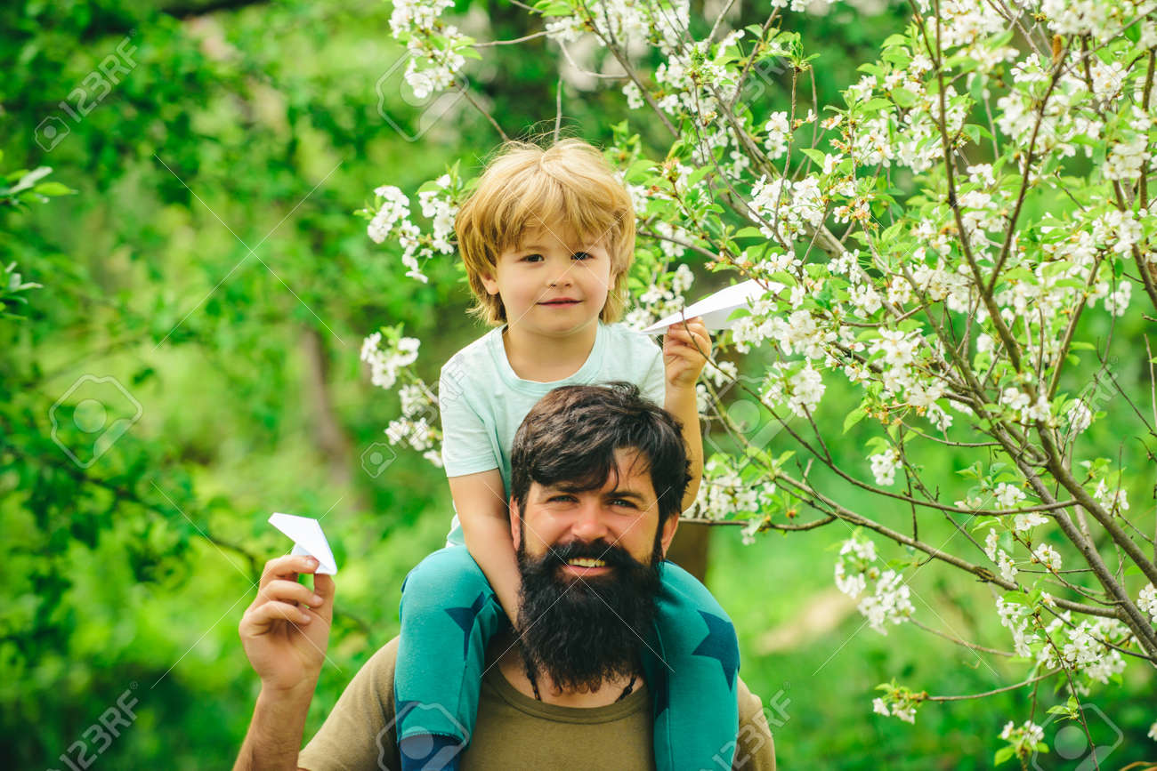 Happy Fathers Day copy space. Cute son holding father. Love you daddy on green nature background. Father and son in the garden together. - 163244717