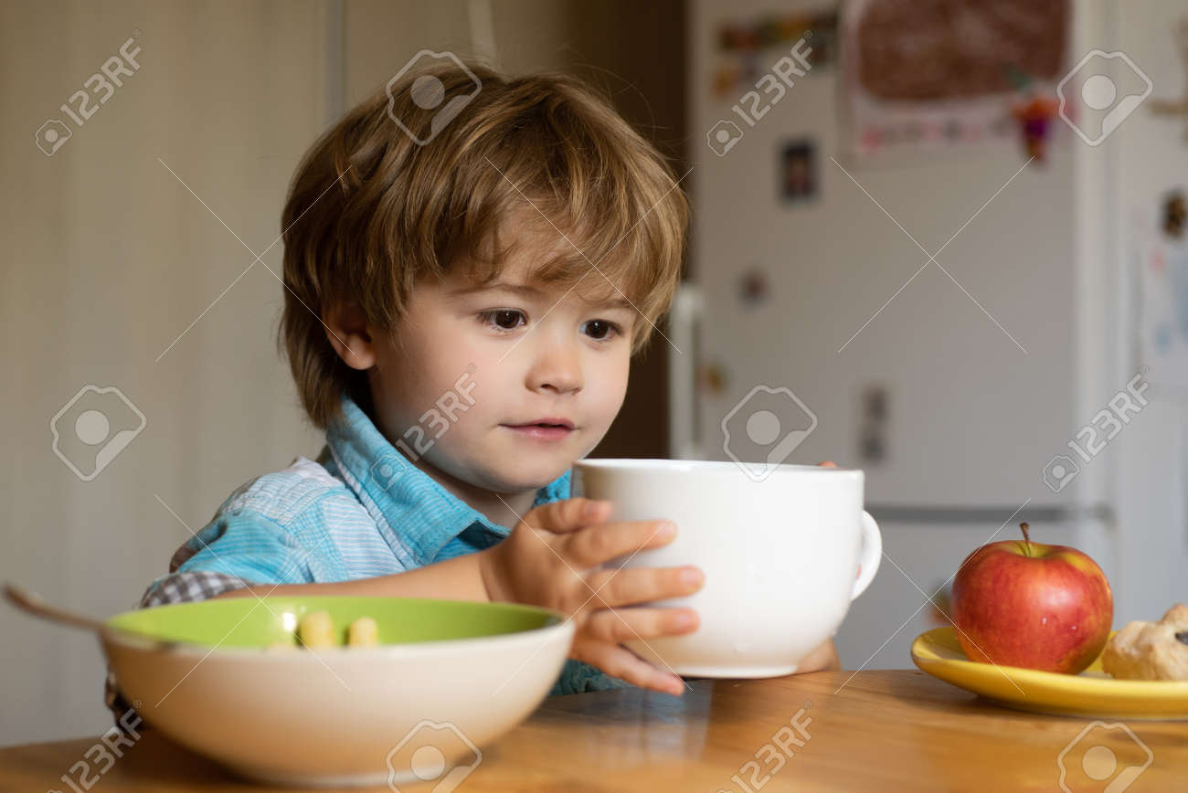 Food for children. Kid boy on the kitchen. Child toddler with lunch at home. Baby food. Fruit snack. - 163244737