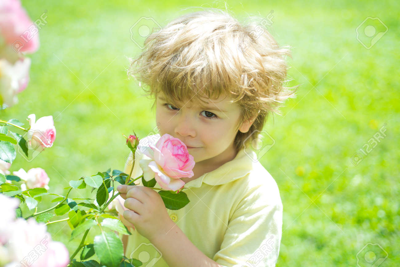 Kid and rose. Children with nature concept. - 163411690