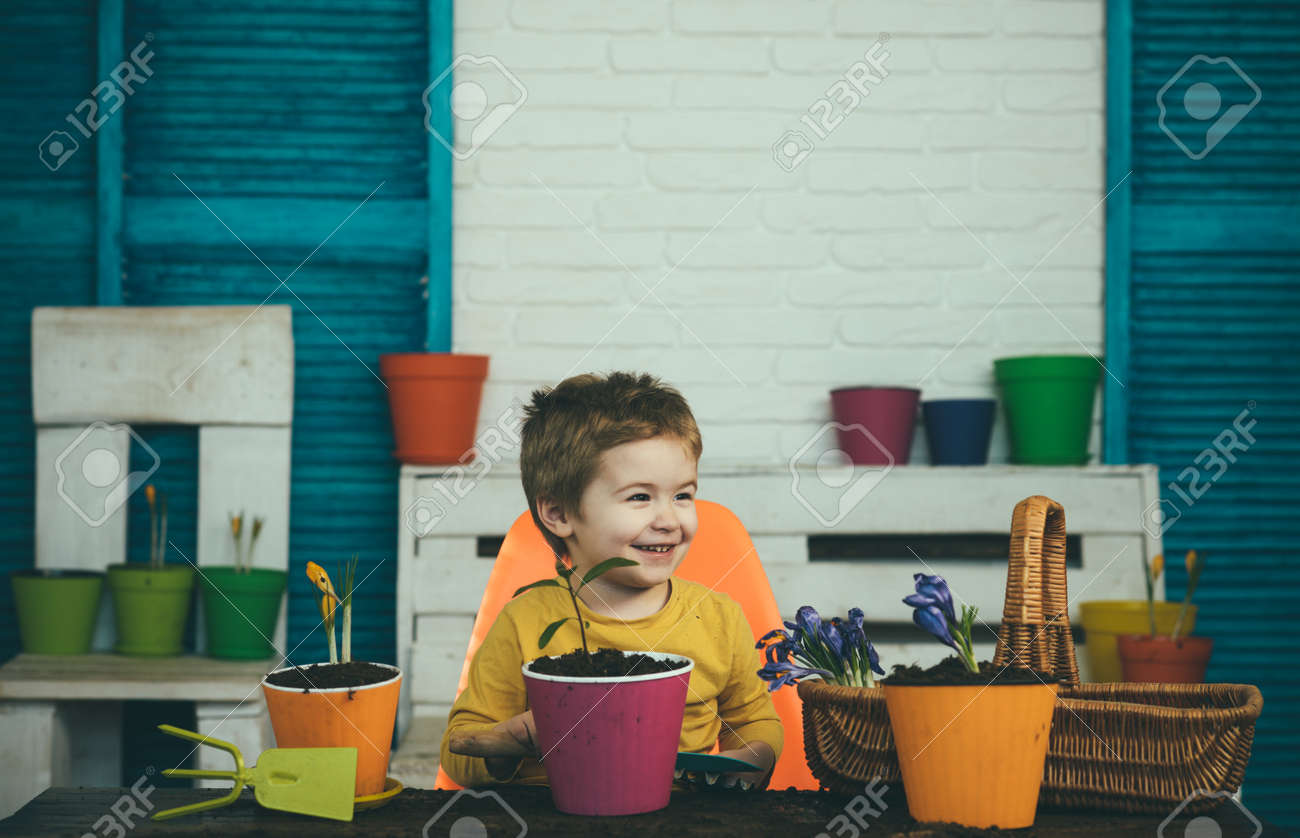 Happy child with plants. Vegan or vegeterian concept. - 163412232