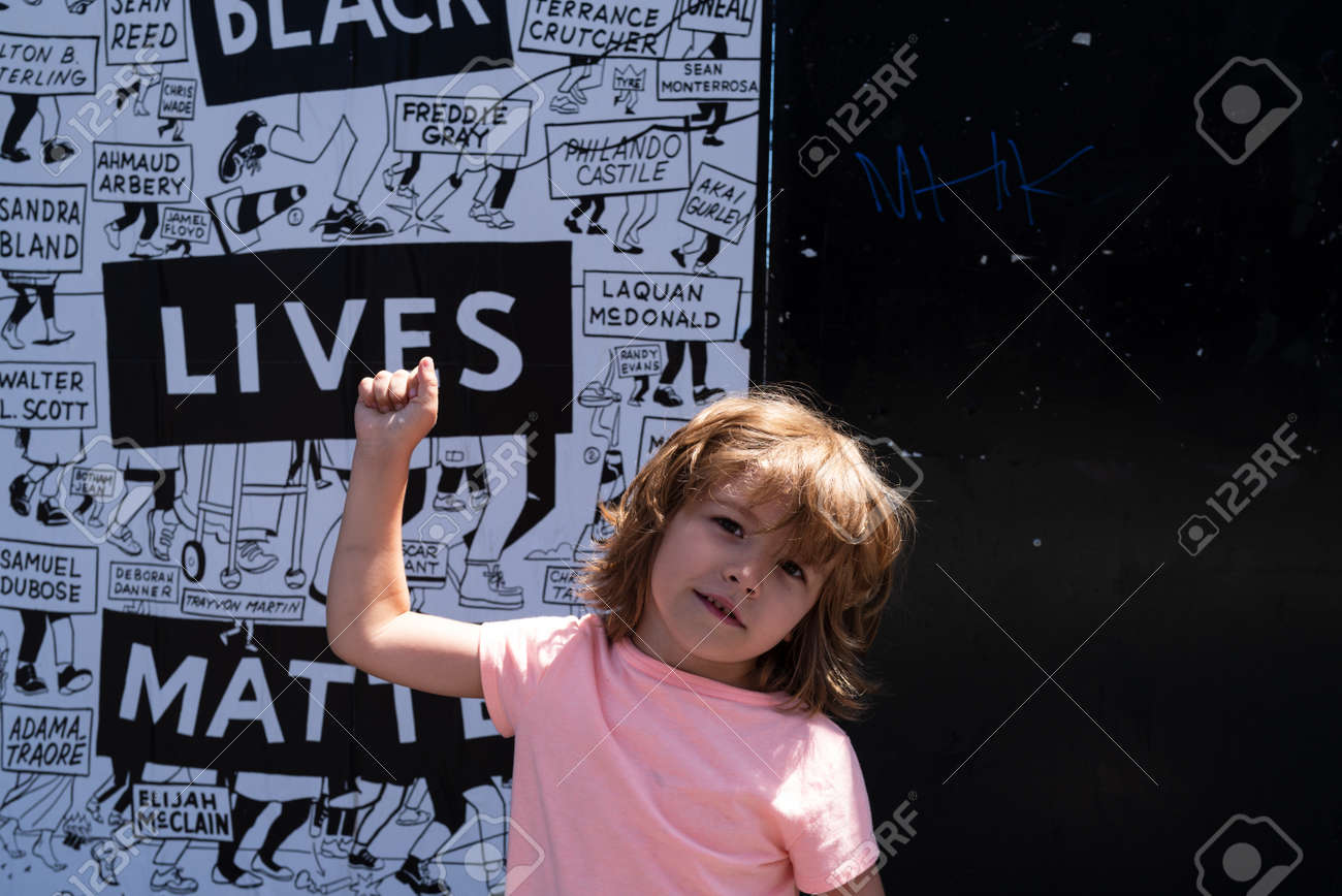 Miami, FL, USA - JULY, 2020: Happy child and Black lives matter poster. - 163315009