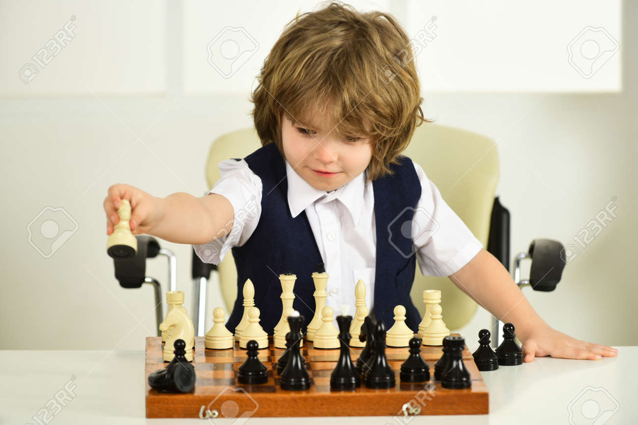 Chess for kids. Strategy and difficult decisions. Chessboard. Boy child plays chess. Mind, intelligence, intellect, child brain. - 170441006