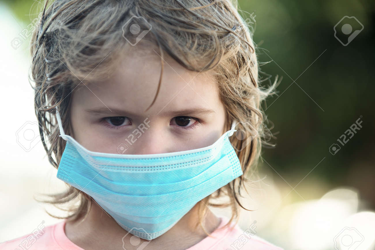 A sad child in a mask against virus. Pandemic. - 170923657