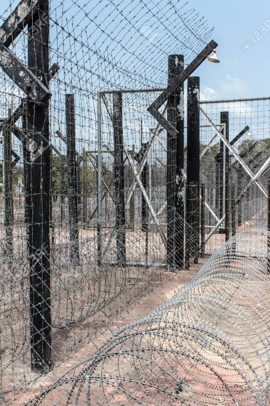 Barb Wire Fence / Border - Prison Camp Stock Photo, Picture And ...