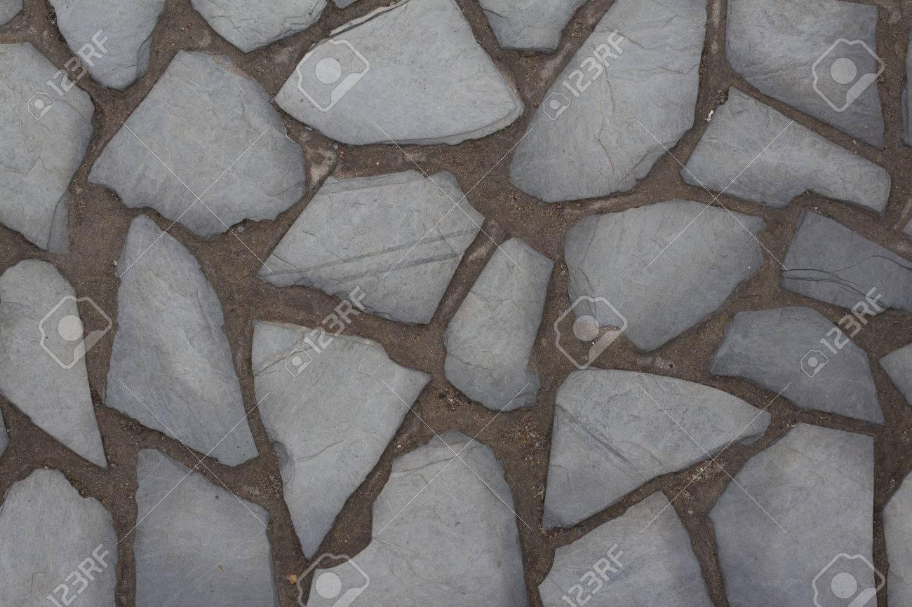 Mur de pierre naturelle de fond en pierre sol pavé