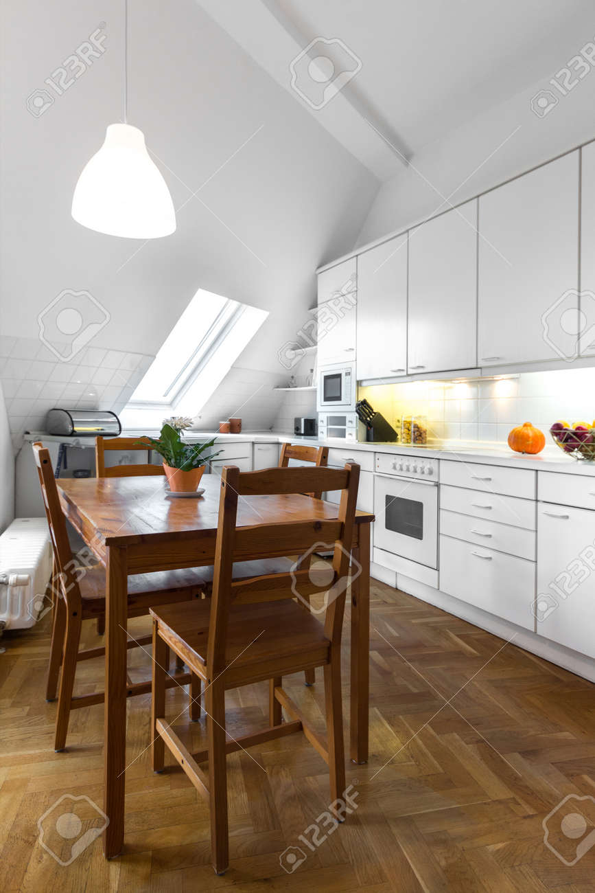 Classic White Kitchen With Wooden Table And Parquet Floor Stock ...