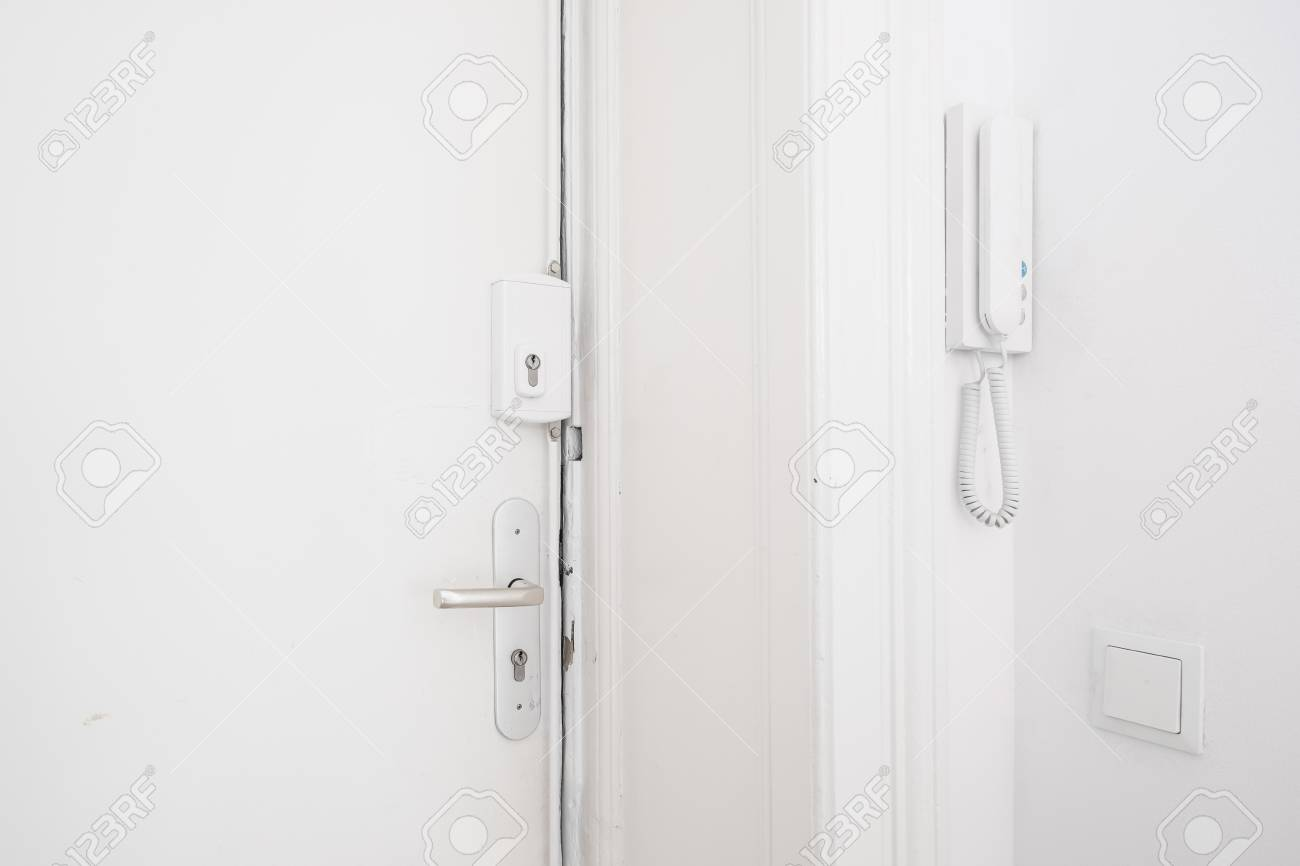 Entrance Door Handle Bar Lock And Interphone System On White