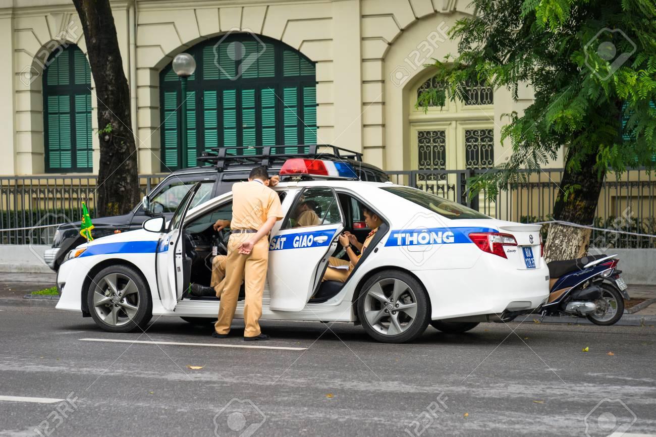 Hanoi, Vietnam - Sep 2, 2016: Vietamese police sedan with red/blue