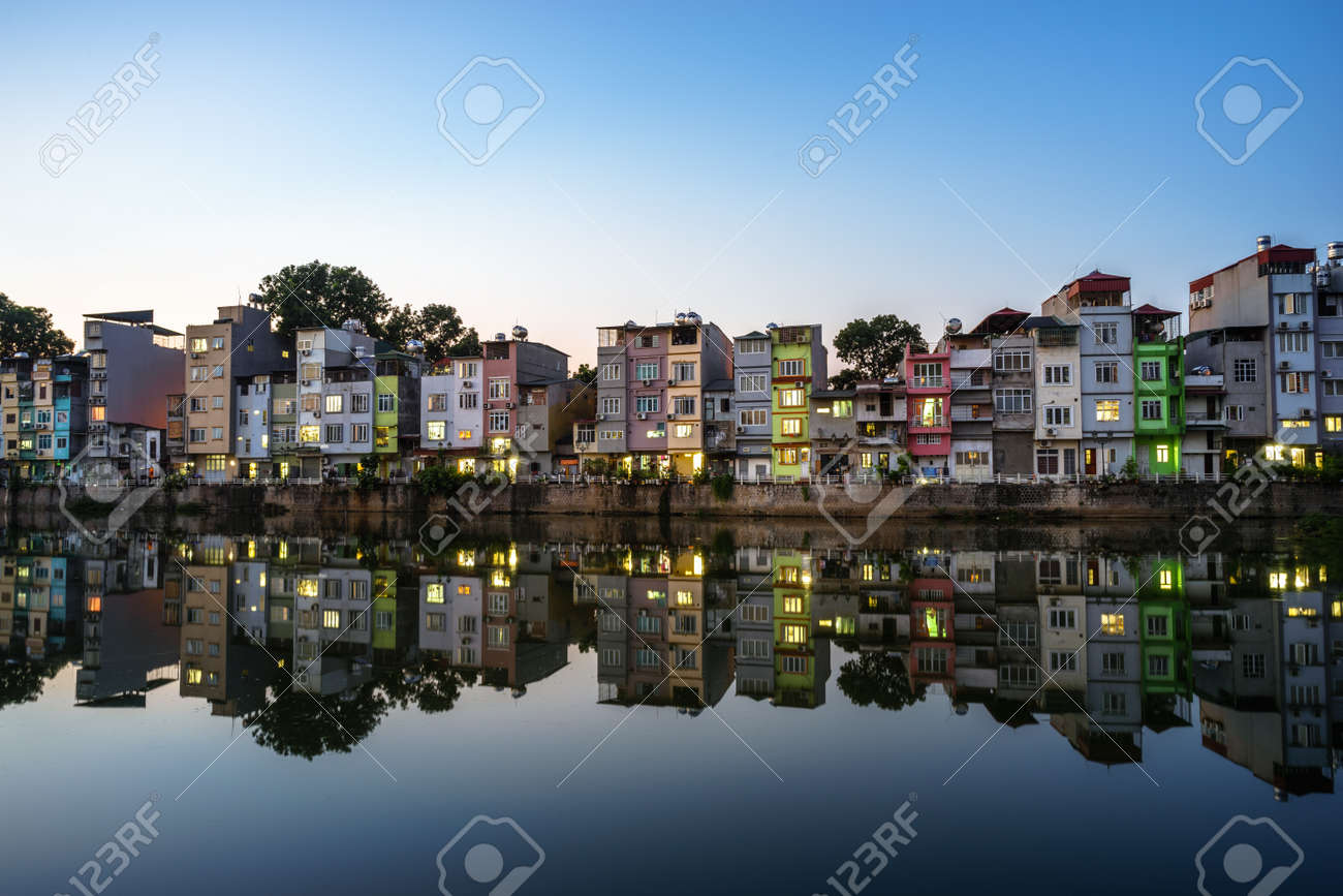 Hanoi Cityscape At Sunset Resident Buildings By Tien Bien Lake