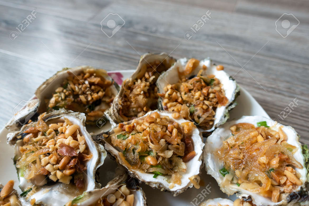 Grilled Oysters With oil, green onion, roasted peanut