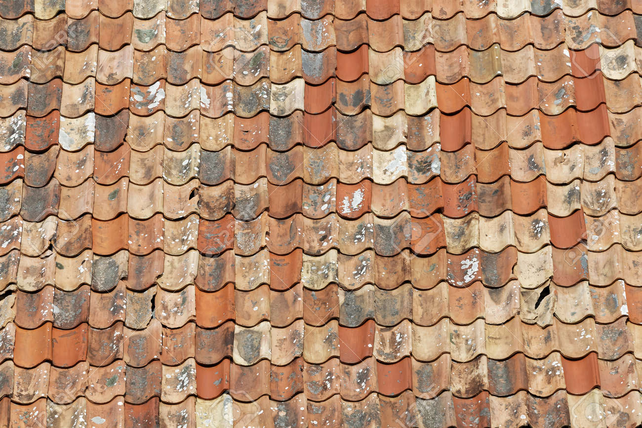 Different Shades Of Orange Roof Made Of Aged Roofing Tiles In Different Shades Of Orange