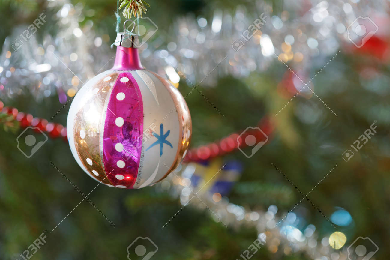 christmas decorations like balls and christmas tinsel in the christmas tree stock photo 69785991