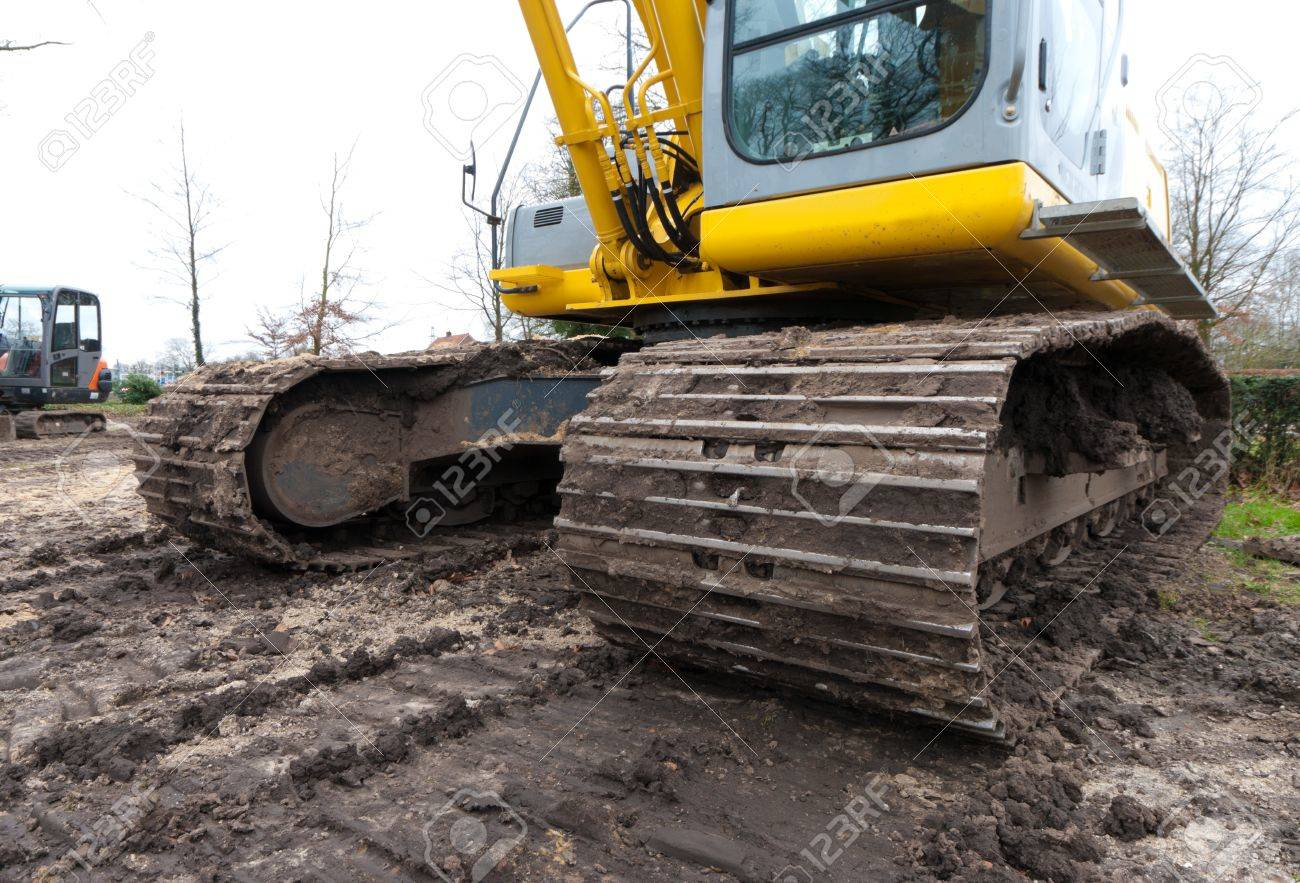 wide angle view of the tracks of an excavator stock photo picture