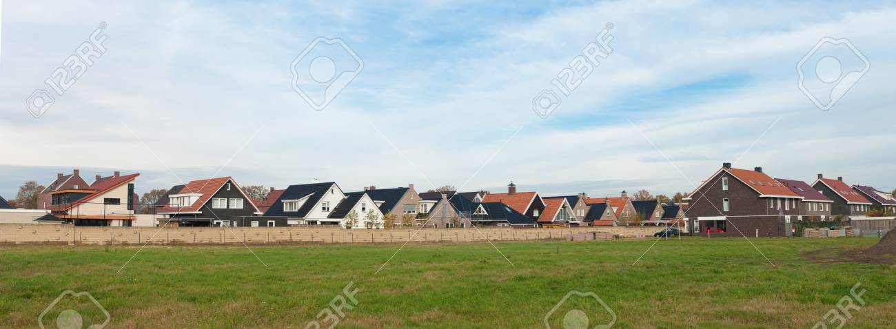 panoramic view of a residential area behind a wall - 11764238