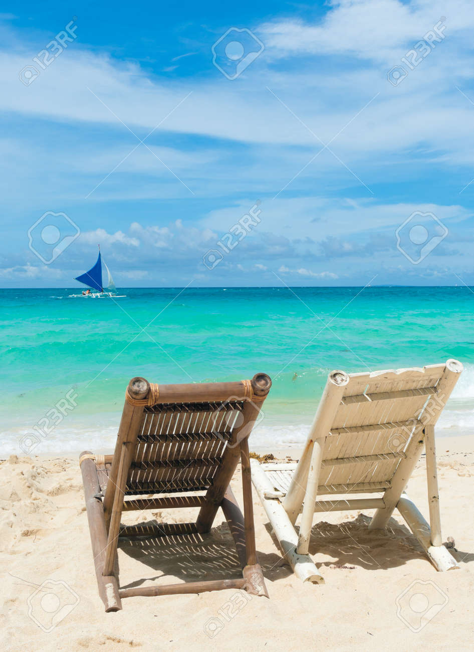 Beach with chairs - Stock Photo Tropical Beach With Two Beach Chairs Facing The Blue Sea