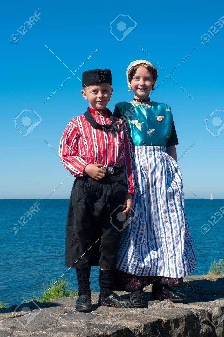 Boy and girl show original costumes for tourists on the traditional Urkerdays on May 26, 2012 in Urk, Netherlands. Urk has the largest fishing fleet of the Netherlands. Stock Photo - 14340115