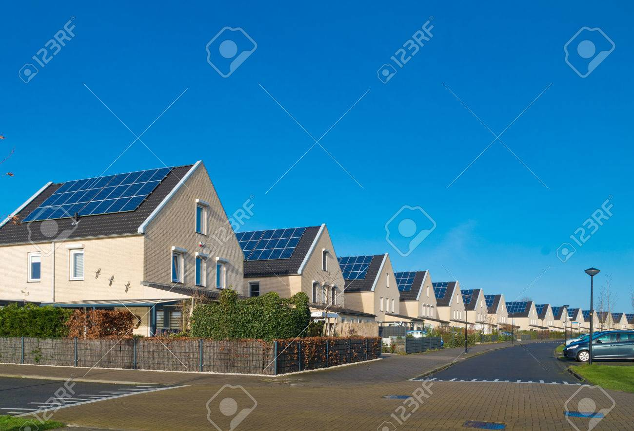 row of newly build modern houses with solar panels in the netherlands - 65543325