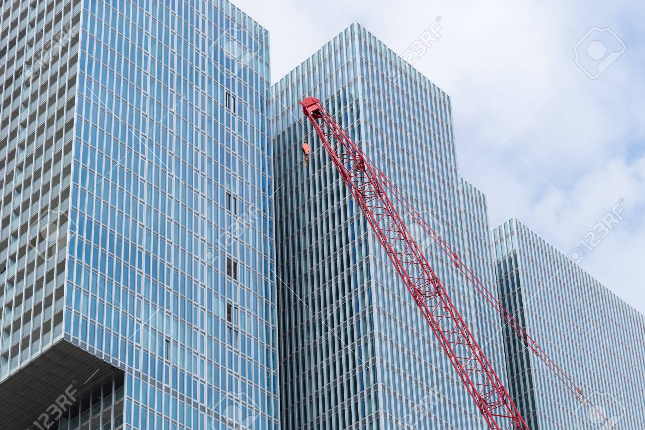 ROTTERDAM, NETHERLANDS - MAY 14, 2016: Construction crane in front of the  famous